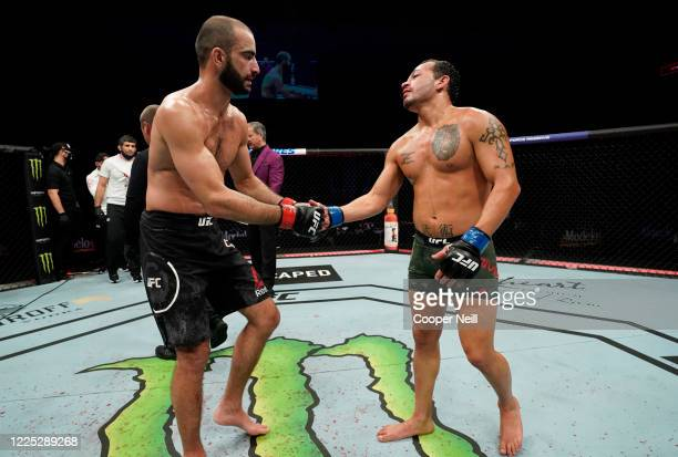 Giga Chikadze of Georgia and Irwin Rivera of Mexico react after their featherweight fight during the UFC Fight Night event at VyStar Veterans...