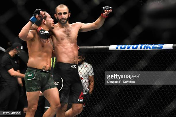 Giga Chikadze of Georgia and Irwin Rivera of the United States react after their Featherweight bout during UFC Fight Night at VyStar Veterans...