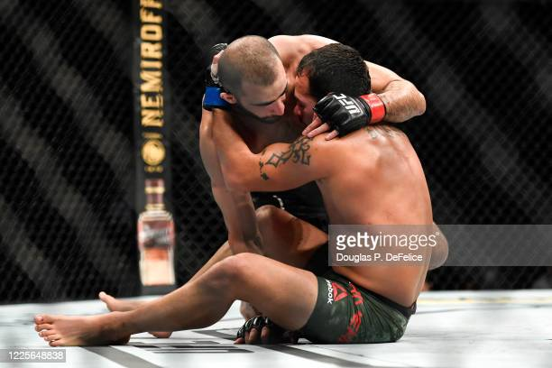 Giga Chikadze of Georgia grapples Irwin Rivera of the United States in their Featherweight bout during UFC Fight Night at VyStar Veterans Memorial...