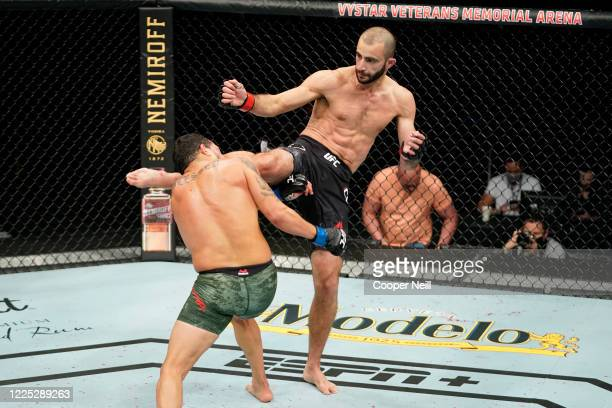 Giga Chikadze of Georgia kicks Irwin Rivera of Mexico in their featherweight fight during the UFC Fight Night event at VyStar Veterans Memorial Arena...