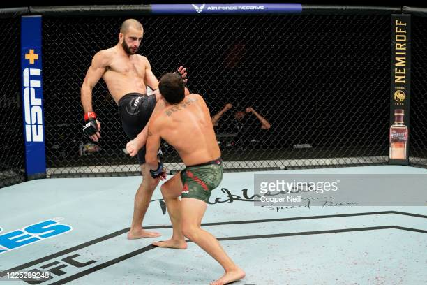 Giga Chikadze of Georgia knees Irwin Rivera of Mexico in their featherweight fight during the UFC Fight Night event at VyStar Veterans Memorial Arena...