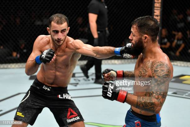 Giga Chikadze of Georgia punches Brandon Davis in their featherweight bout during the UFC Fight Night event at Royal Arena on September 28 2019 in...