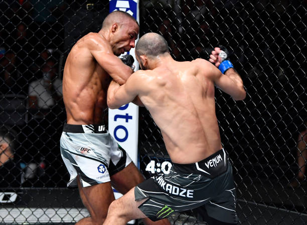 Giga Chikadze of Georgia punches Edson Barboza of Brazil in a featherweight fight during the UFC Fight Night event at UFC APEX on August 28, 2021 in...