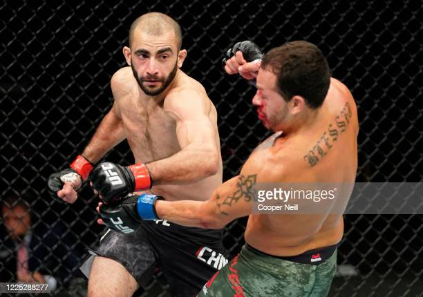 Giga Chikadze of Georgia punches Irwin Rivera of Mexico in their featherweight fight during the UFC Fight Night event at VyStar Veterans Memorial...