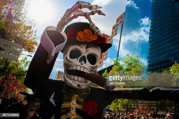 A gigantic Calaca figure a Mexican icon that represents the deceased is carried through the street during the Day of the Dead parade October 29 2016...