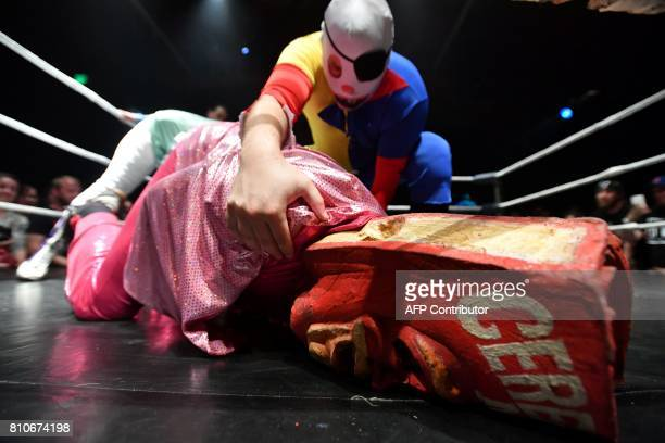 Giggles pins down Cereal Man during Hoodslam an underground professional wrestling event in Oakland California on July 7 2017 Hoodslam performances...