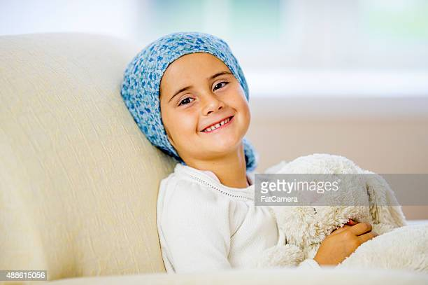 Giggling Little Girl Facing Cancer