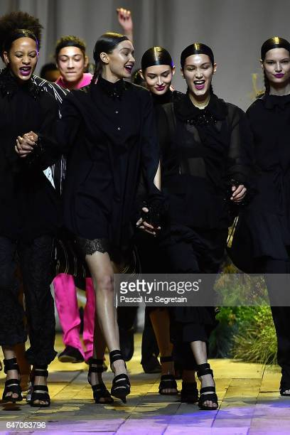 Gigi and Bella Hadid walk the runway during the HM Studio show as part of the Paris Fashion Week on March 1 2017 in Paris France