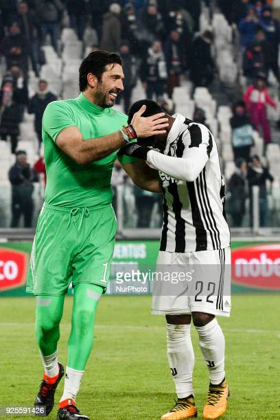 Gigi Buffon and Juventus midfielder Kwadwo Asamoah celebrate victory after the Coppa Italia semi final football match JUVENTUS ATALANTA on at the...