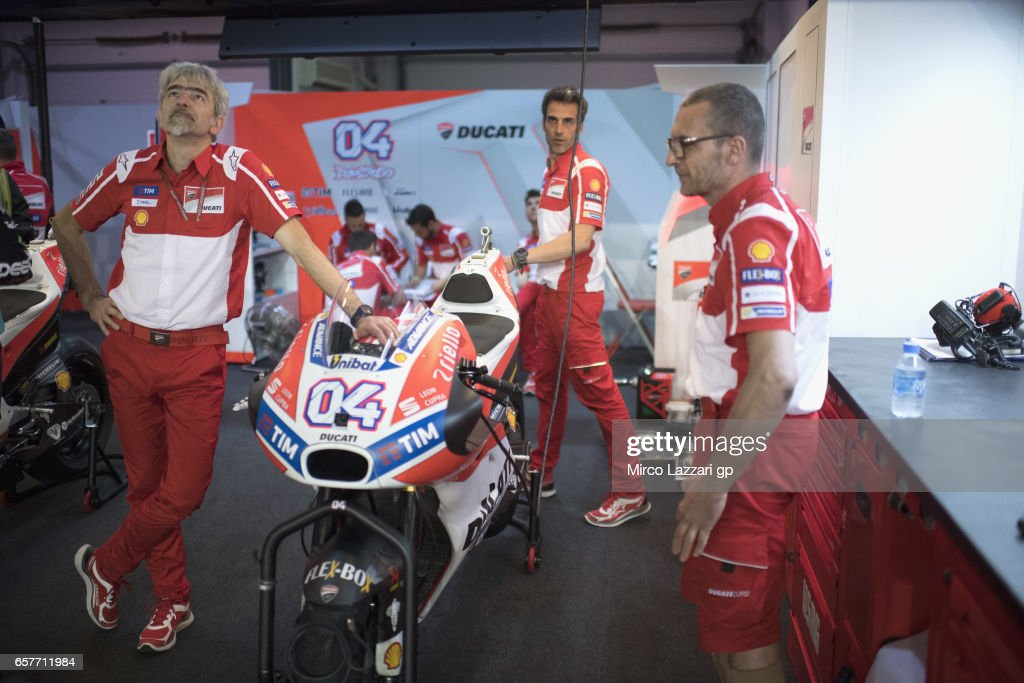 Gigi Dall'Igna of Italy and Ducati Team (L) looks on in box during the MotoGp of Qatar - Qualifying at Losail Circuit on March 25, 2017 in Doha, Qatar.
