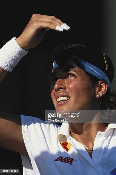 Gigi Fernandez of the United States shields her eyes against the sun during her Women's Singles quarter final match against Zina Garrison Jackson at...
