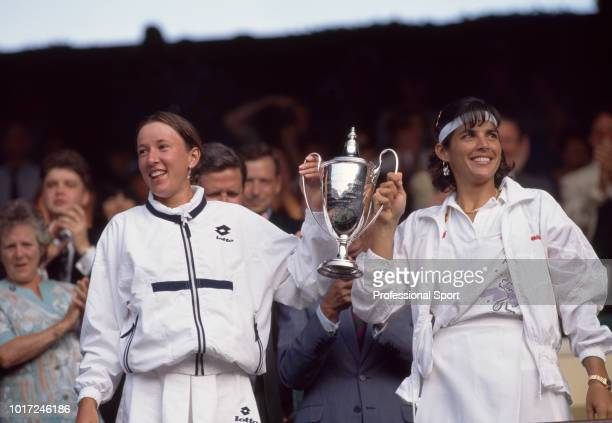 Gigi Fernandez of the USA and Natasha Zvereva of Belarus pose with the trophy after defeating Jana Novotna of the Czech Republic and Arantxa Sanchez...