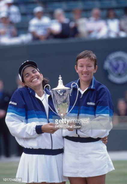 Gigi Fernandez of the USA and Natasha Zvereva of Belarus pose with the trophy after defeating Nicole Arendt of the USA and Manon Bollegraf of the...