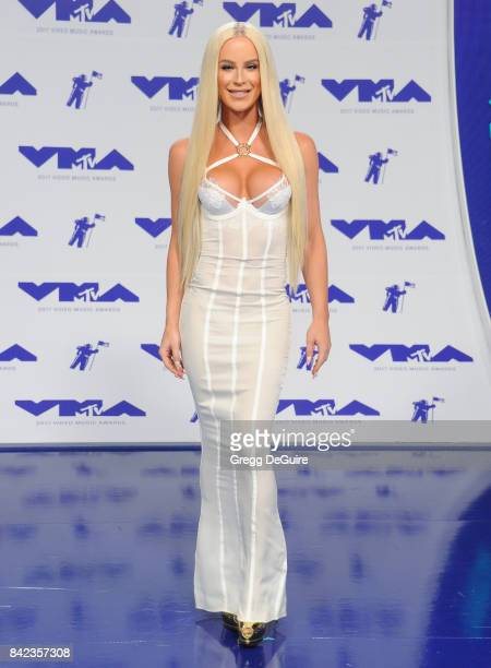 Gigi Gorgeous arrives at the 2017 MTV Video Music Awards at The Forum on August 27 2017 in Inglewood California