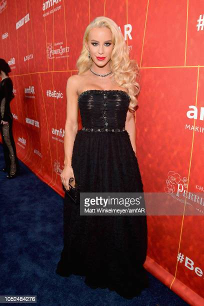 Gigi Gorgeous attends the amfAR Gala Los Angeles 2018 at Wallis Annenberg Center for the Performing Arts on October 18 2018 in Beverly Hills...