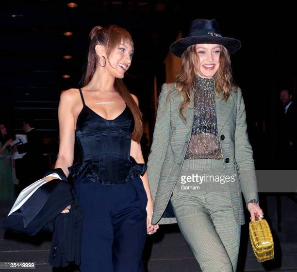 Gigi Hadid and Bella Hadid arrive at Marc Jacob and Char DeFrancesco wedding reception at the Pool on April 6 2019 in New York City