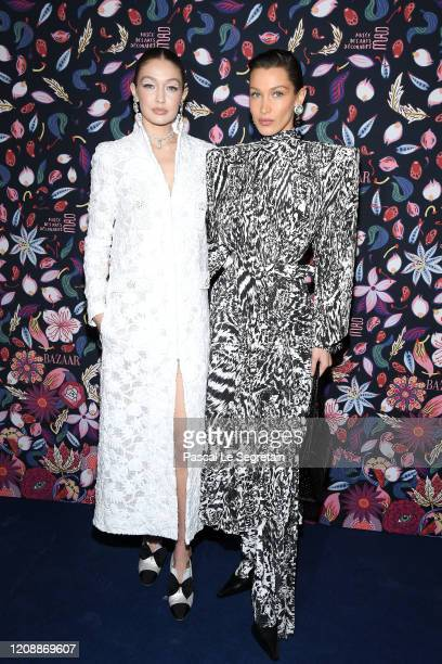 Gigi Hadid and Bella Hadid attend the Harper's Bazaar Exhibition as part of the Paris Fashion Week Womenswear Fall/Winter 2020/2021 At Musee Des Arts...