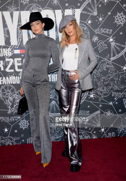Gigi Hadid and Bella Hadid attend TOMMYNOW New York Fall 2019 - Front Row & Atmosphere at The Apollo Theater on September 08, 2019 in New York City.