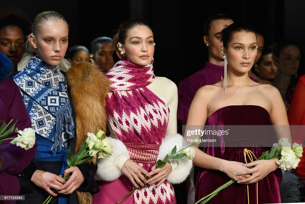 Gigi Hadid (center) and Bella Hadid (R) walk the runway for Prabal Gurung during New York Fashion Week: The Shows at Gallery I at Spring Studios on February 11, 2018 in New York City.