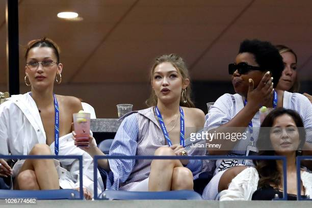 Gigi Hadid and Bella Hadid watch on during the women's singles quarterfinal match between Serena Williams of The United States and Karolina Pliskova...