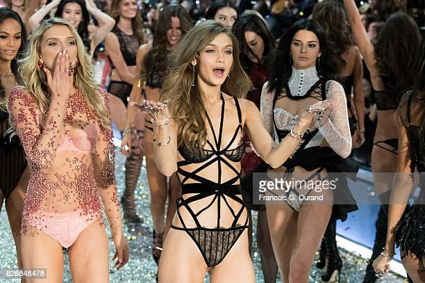 Gigi Hadid and Kendall Jenner walk the runway at the Victoria's Secret Fashion Show on November 30 2016 in Paris France