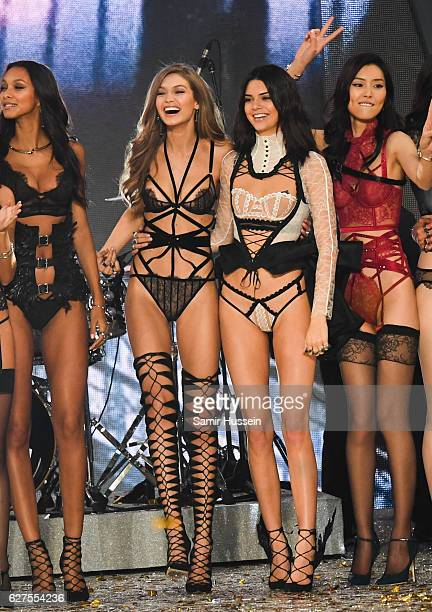 Gigi Hadid and Kendall Jenner walk the runway during the annual Victoria's Secret fashion show at Grand Palais on November 30 2016 in Paris France
