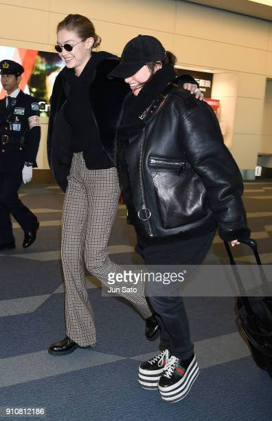 Gigi Hadid and makeup artist Erin Parsons are seen at Haneda Airport on January 27 2018 in Tokyo Japan