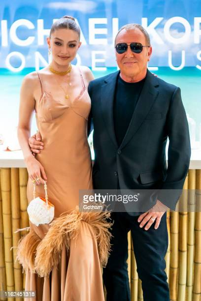 Gigi Hadid and Michael Kors are seen at Michael Kors in Rockefeller Center on July 16 2019 in New York City