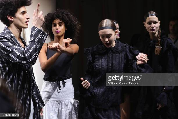 Gigi Hadid and other models plays backstage before the HM Studio show as part of the Paris Fashion Week on March 1 2017 in Paris France