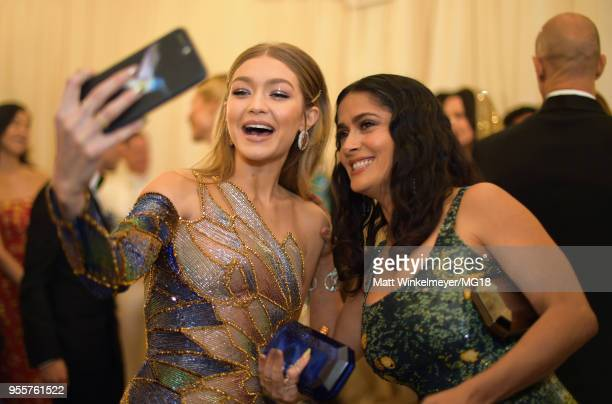 Gigi Hadid and Salma Hayek attend the Heavenly Bodies Fashion The Catholic Imagination Costume Institute Gala at The Metropolitan Museum of Art on...