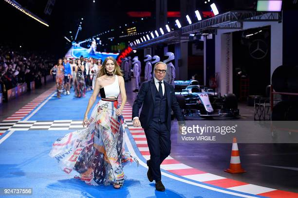 Gigi Hadid and Tommy Hilfiger walk the runway at the Tommy Hilfiger Ready to Wear Spring/Summer 2018 fashion show during Milan Fashion Week...