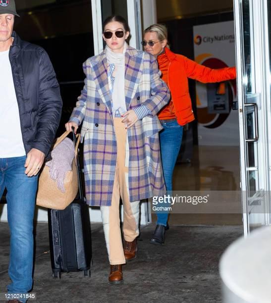 Gigi Hadid and Yolanda Hadid return to New York from Paris on March 03 2020 in New York City