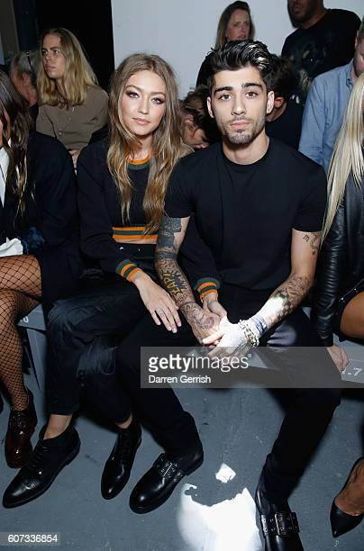 Gigi Hadid and Zayn Malik attend the Versus Versace show during London Fashion Week Spring/Summer collections 2016/2017 on September 17 2016 in...