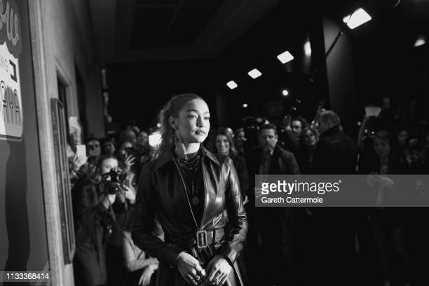 Gigi Hadid arrives at the Tommy Hilfiger TOMMYNOW Spring 2019 TommyXZendaya Premieres at Theatre des ChampsElysees on March 02 2019 in Paris France