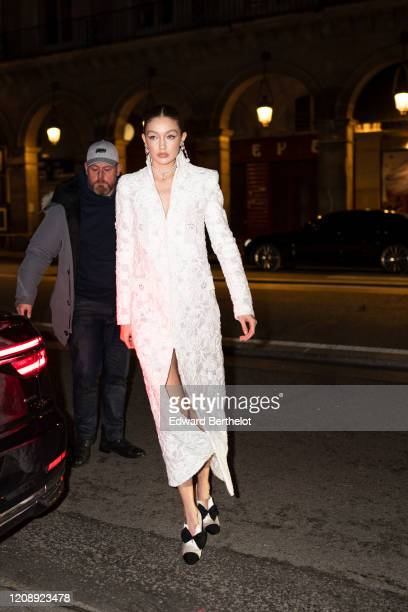 Gigi Hadid attends the Harper's Bazaar Exhibition as part of the Paris Fashion Week Womenswear Fall/Winter 2020/2021 At Musee Des Arts Decoratifs on...