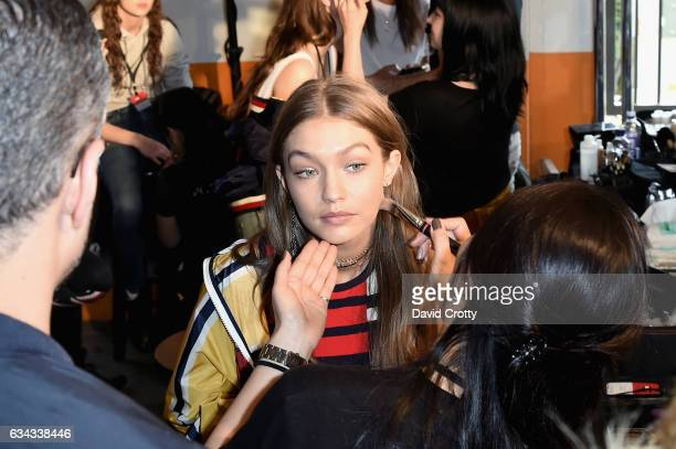 Gigi Hadid attends the Tommy Hilfiger Spring 2017 Women's Runway Show Backstage at Windward Plaza on February 8 2017 in Venice California