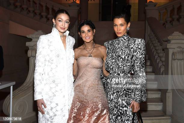 Gigi Hadid, Demi Moore and Bella Hadid attend the Harper's Bazaar Exhibition as part of the Paris Fashion Week Womenswear Fall/Winter 2020/2021 At...