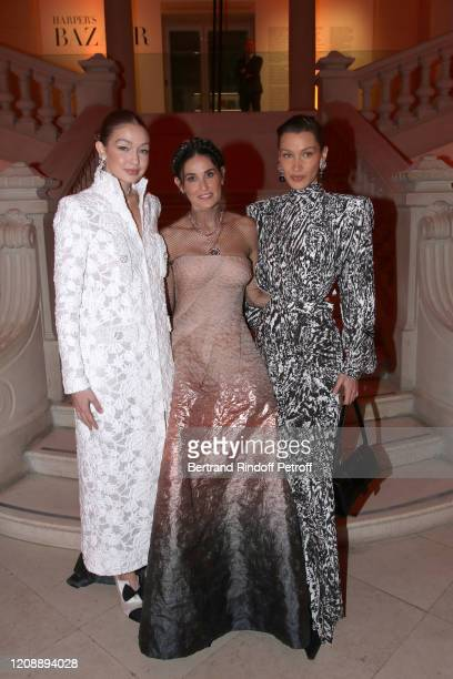 Gigi Hadid, Demi Moore and Bella Hadid attends the Harper's Bazaar Exhibition as part of the Paris Fashion Week Womenswear Fall/Winter 2020/2021 At...