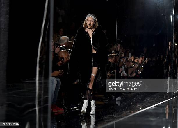 Gigi Hadid displays fashions during the Fenty PUMA by Rihanna show during the Fall 2016 New York Fashion Week in New York on February 12 2016 / AFP /...