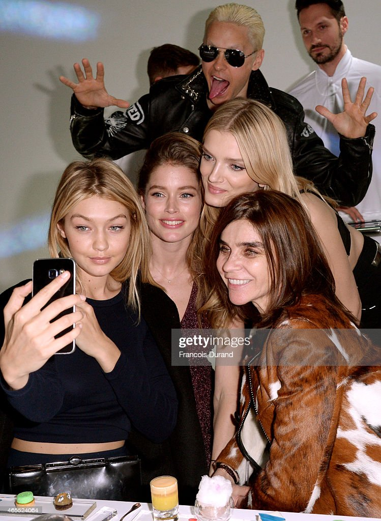 Gigi Hadid, Doutzen Kroes, Lily Donaldson, Jared Leto and Carine Roitfeld attend the Paris Fashion Week Tasting Night with Galaxy featuring Brad Goreski, model Jessica Stam and Executive Vice President of Global Marketing, IT & Mobile Division at Samsung Electronics, Younghee Lee at Four Seasons Hotel George V on March 7, 2015 in Paris, France.