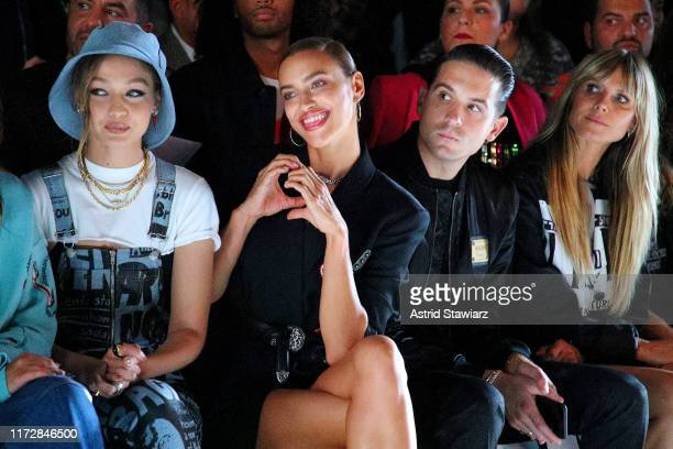 Gigi Hadid Irina Shayk GEazy and Heidi Klum attend the Jeremy Scott front row during New York Fashion Week The Shows at Gallery I at Spring Studios...