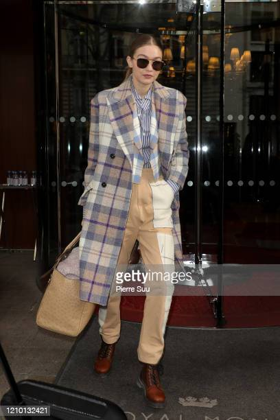"""Gigi Hadid is seen leaving the """"Royal Monceau"""" hotel on March 03, 2020 in Paris, France."""