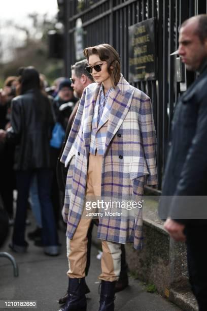Gigi Hadid is seen outside the Miu Miu show during Paris Fashion week Womenswear Fall/Winter 2020/2021 Day Nine on March 03 2020 in Paris France