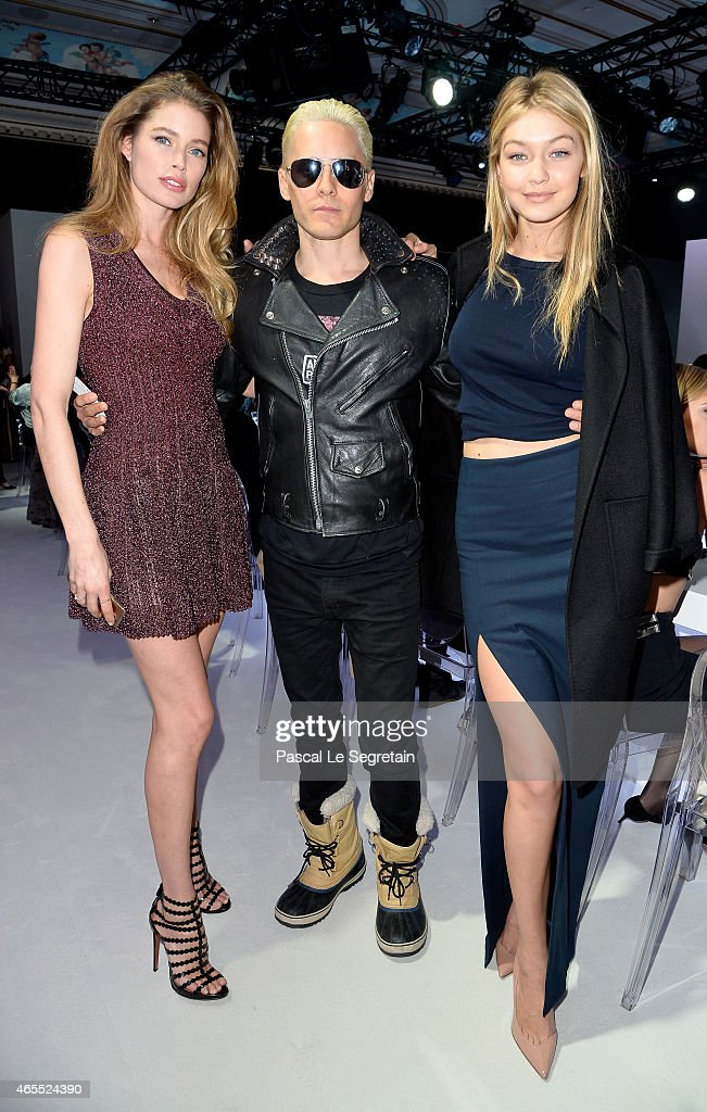 Gigi Hadid, Jared Leto and Doutzen Kroes, the face of Samsung Netherlands attend the Paris Fashion Week Tasting Night with Galaxy featuring Brad Goreski, model Jessica Stam and Executive Vice President of Global Marketing, IT & Mobile Division at Samsung Electronics, Younghee Lee at Four Seasons Hotel George V on March 7, 2015 in Paris, France.