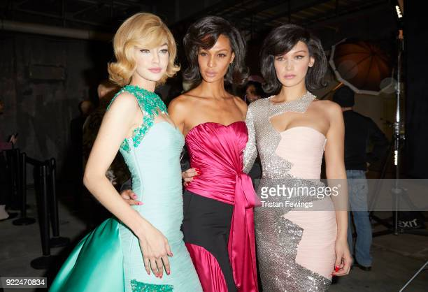 Gigi Hadid Joan Smalls and Bella Hadid seen backstage ahead of the Moschino show during Milan Fashion Week Fall/Winter 2018/19 on February 21 2018 in...