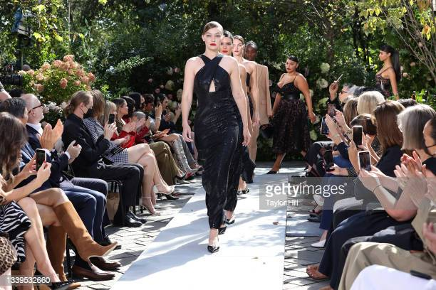 Gigi Hadid, Kendall Jenner, and more walk the runway during the finale of the Michael Kors S/S 2022 fashion show during New York Fashion Week at...