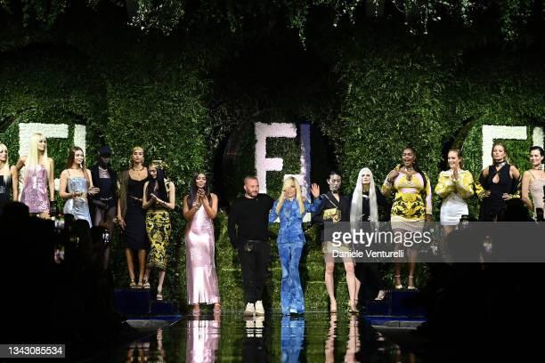 Gigi Hadid, Maria Carla Boscono, Naomi Campbell, fashion designer Kim Jones, Donatella Versace and Kate Moss acknowledge the applause of the audience...