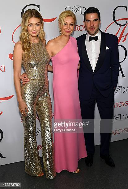 Gigi Hadid Nadja Swarovski and Zachary Quinto pose on the winners walk at the 2015 CFDA Fashion Awards at Alice Tully Hall at Lincoln Center on June...