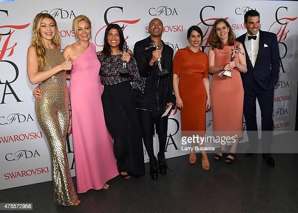 Gigi Hadid Nadja Swarovski Rosie Assoulin Shayne Oliver Floriana Gavriel Rachel Mansur and Zachary Quinto pose on the winners walk at the 2015 CFDA...