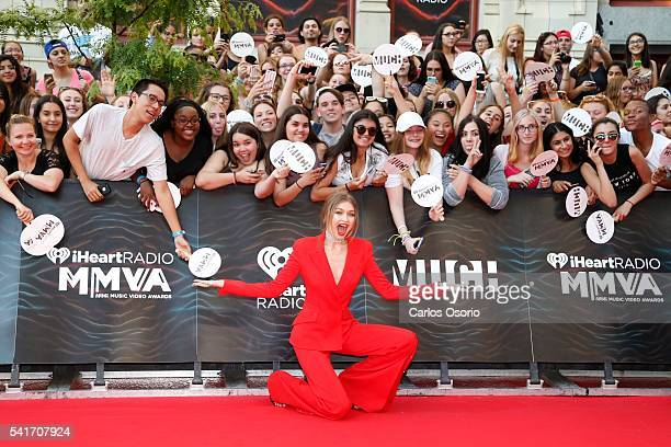 TORONTO ON JUNE 19 Gigi Hadid poses on the red carpet at the IHeartRadio MuchMusic Video Awards on June 19 2016